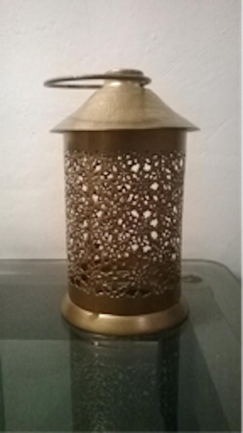 Antique hut candle holder
