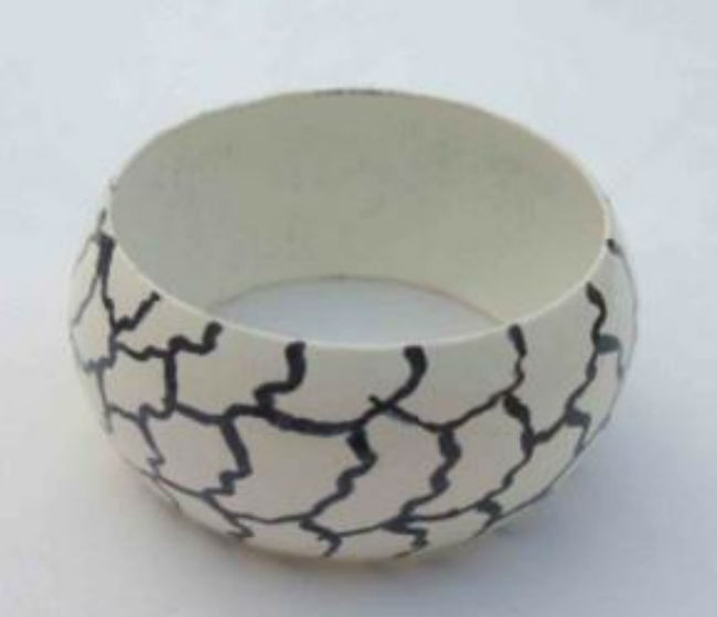 Cream Color over Black Lining Iron Napkin Ring