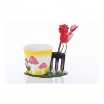 Red Bird Sitting On Garden Fork With Planter