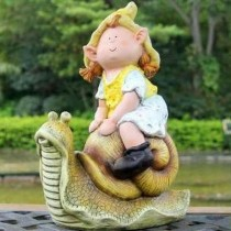 Girl Sitting on Snail Garden Sculpture