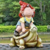Girl Sitting on Tortoise Garden Sculpture