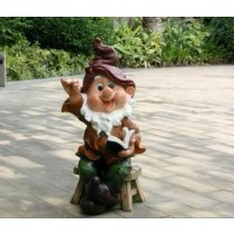Gnome Sitting on Stool With Book Garden Sculpture