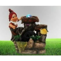 Gnome Standing on Water Fountain With Bird