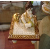 Gold Plated Lord Krishna Sitting on Short stool
