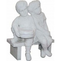 Sculpture of little boy and girl